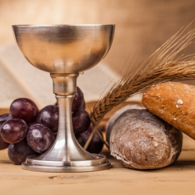 Chalice, grapes, and bread