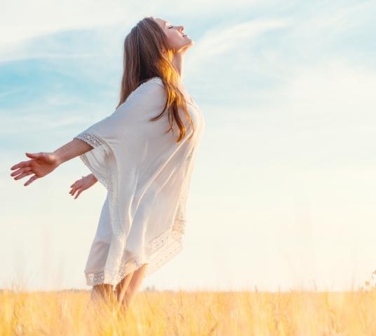 Woman breathing air in wheat field